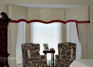 Cornice and drapes transitional bedroom
