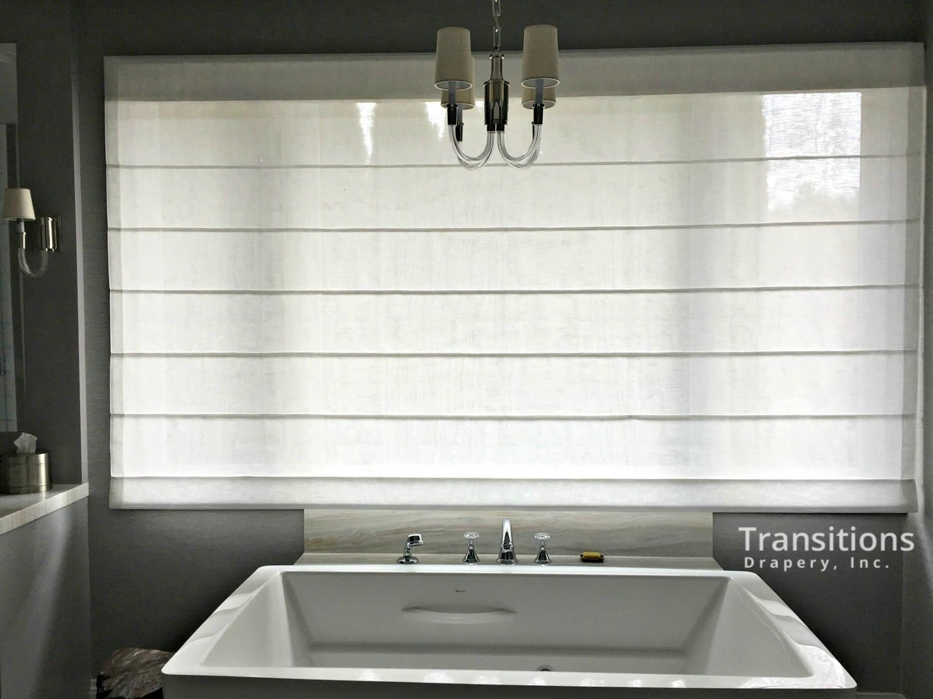 Roman shades over bathtub