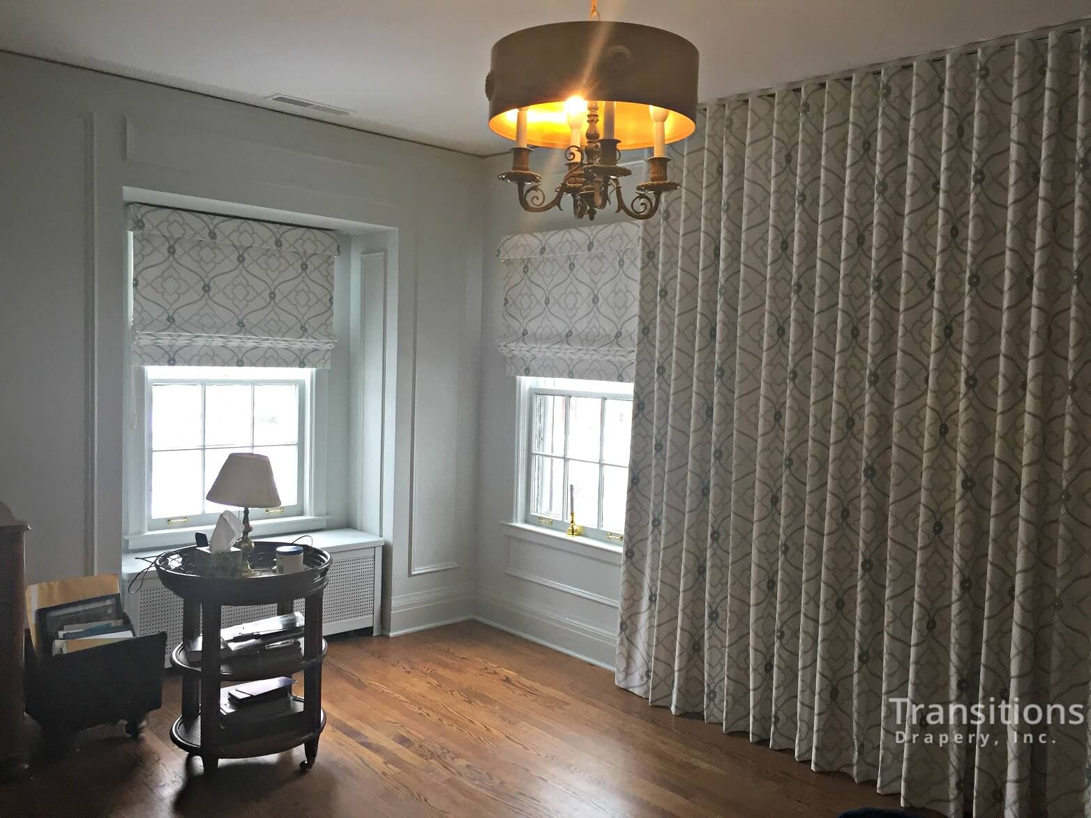 custom made drapes and matching roman shades for large wall