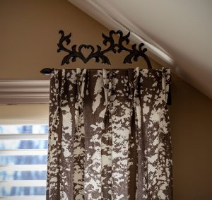 Decorative drapery rods curtain rod side panel