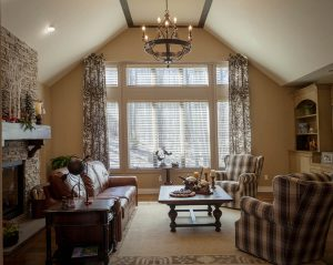 Great room drapery and blinds with decorative rod